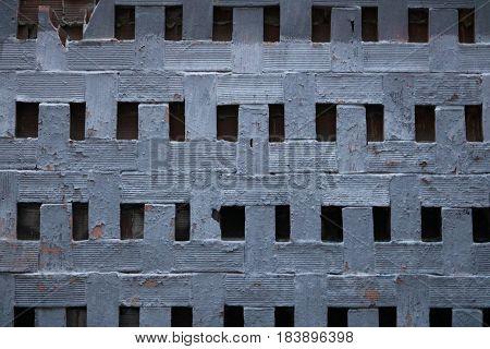 Pared gris de ladrillos con textura irregular