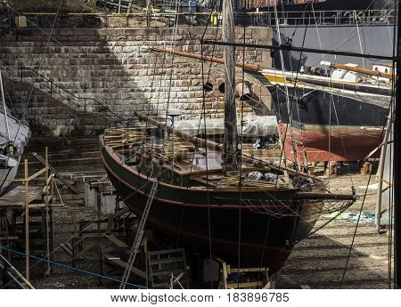 sail boat in maintenance in a drydock