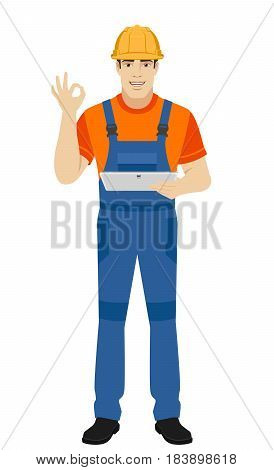 Builder holding digital tablet and showing a okay hand sign. Full length portrait of builder character in a flat style. Vector illustration.