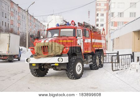 New Urengoy, YaNAO, North of Russia. March 3, 2016. Red fire engine ready for rescue