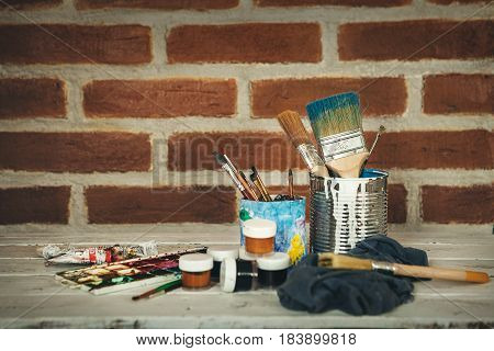 Painting props on brick wall background .