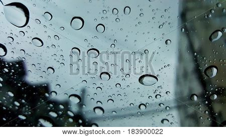 rain water drops on window glass after raining
