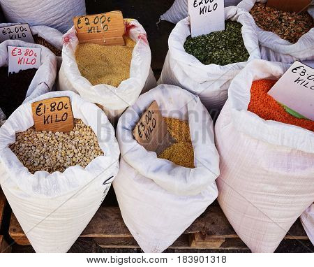 Assortment of dry cereal and beans on the market in Malta natural light