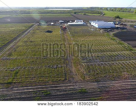 Frameworks Of Greenhouses, Top View. Construction Of Greenhouses In The Field. Agriculture, Agrotech