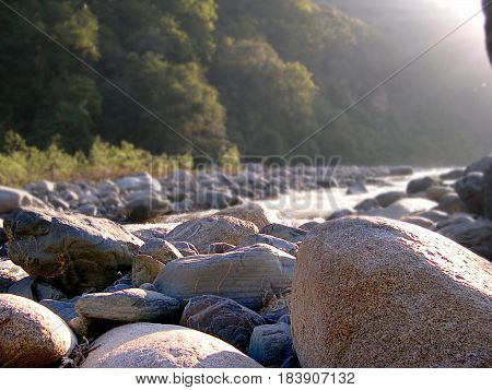 Foreground of river rocks. River rocks closeup