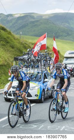 Col de PeyresourdeFrance- July 23 2014: Two cyclists Zakkari Dempster and Jose Pimenta Costa Mendes of Team NetApp-Endura) climbing the road to Col de Peyresourde in Pyrenees Mountains during the stage 17 of Le Tour de France on 23 July 2014.