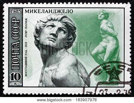 RUSSIA - CIRCA 1975: a stamp printed in Russia shows Rebellious Slave Sculpture by Michelangelo Italian Sculptor Painter and Architect circa 1975