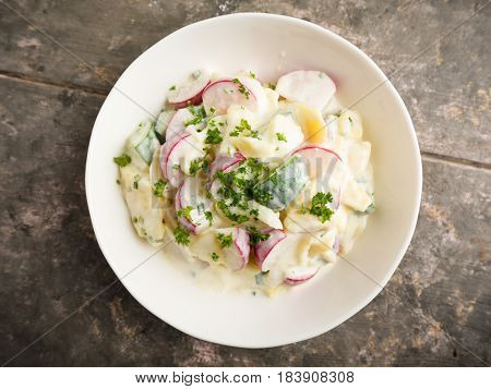 fresh potato salad with radish and cucumber