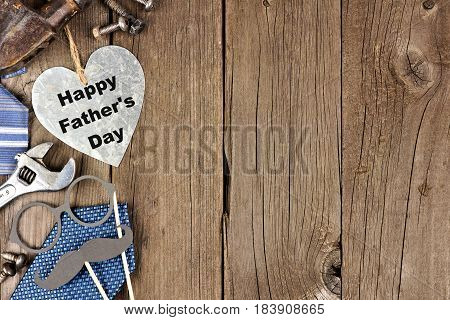 Happy Fathers Day Metallic Heart With Side Border Of Tools And Ties On A Wooden Background