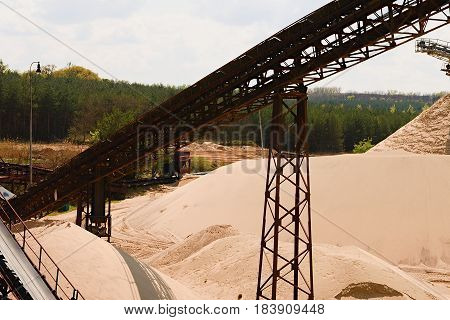 Conveyor Belts And Sand Heaps. Construction Industry. Sand Quarry. Horizontal  Photo.