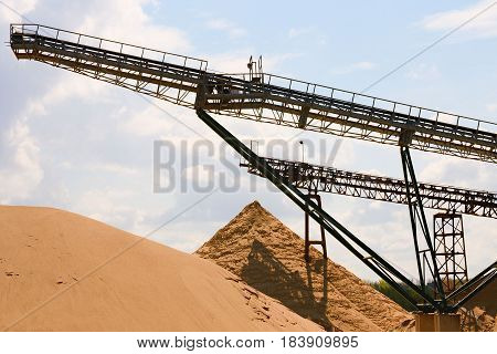 Conveyor Belts And Sand Heaps. Construction Industry. Horizontal  Photo