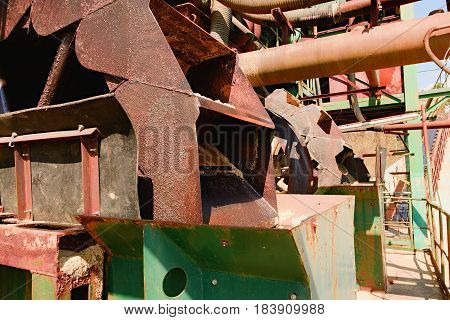 Rusty industrial machine. Rusty parts. Closeup. Metal industrial parts.