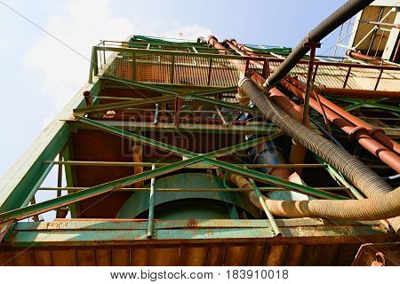 Industrial metal tower. Sand quarry aggregate. industrial metal parts.