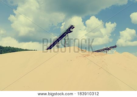 Conveyor Belts And Sand Heaps. Construction Industry. Sand Quarry. Horizontal  Photo. Cross Process