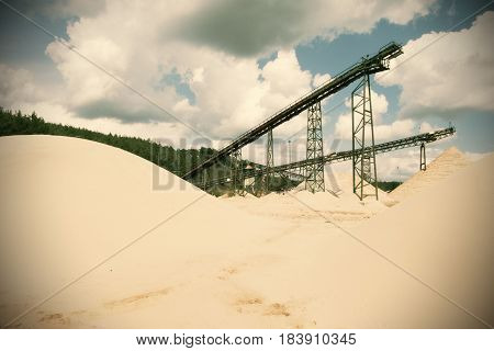 Conveyor Belts And Sand Heaps. Construction Industry. Sand Quarry. Horizontal  Photo. Cinema Effect.