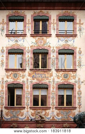 MAINZ, GERMANY - APRIL 20: The facade of the historic lion pharmacy at the cathedral painted with flora and famous heads on April 20 2017 in Mainz.