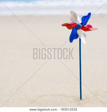 Independence Day USA background with decoration on the sandy beach near the ocean American patriotic concept square Instagram format