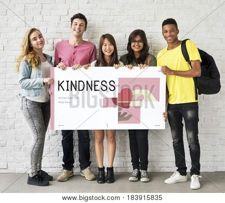 Group of students holding banner of charity donations campaign