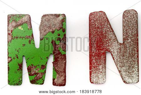 M N wooden letters