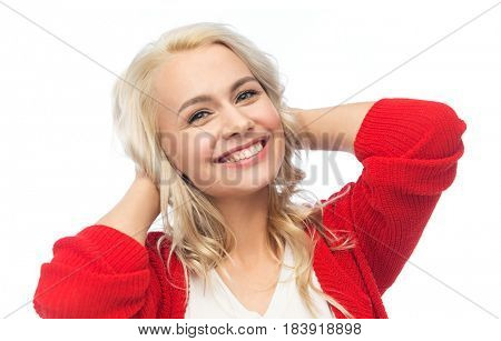 fashion, portrait and people concept - happy smiling young woman in red cardigan