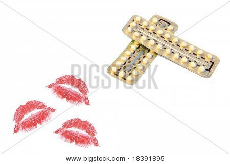 birth control pills and red colored lipstick kisses isolated on white background