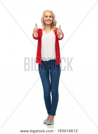 gesture, fashion, portrait and people concept - happy smiling young woman in red cardigan showing thumbs up over white