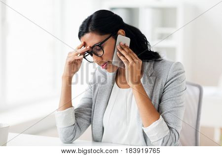 business, people, deadline and technology concept - stressed businesswoman calling on smartphone at office