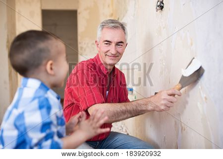 Grandpa Takes Off Wallpaper And Laughing With His Grandson