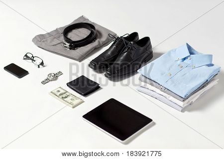 business, style and objects concept - formal male clothes, gadgets and personal stuff on white background