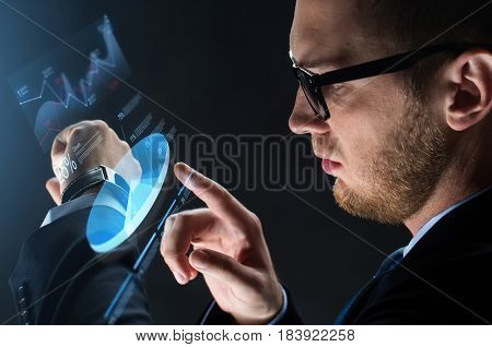 business, people and modern technology concept - close up of businessman with smart watch and virtual screen projection over black background