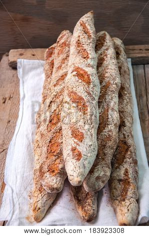 Group Of Fresh Baguettes On A Sackcloth. Close Up And Rustic Style.