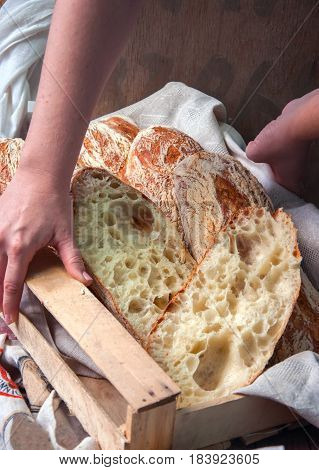 Woman's Hands Holding Wooden Box With Freshly Baked Italian Ciabatta Bread.  Dark Rustic Style.