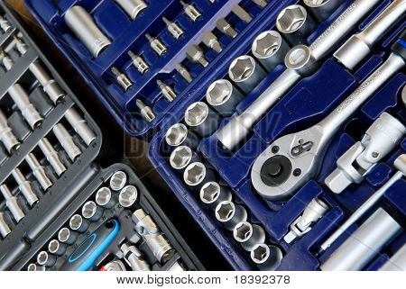 background of the interior of a toolbox filled with lots of tools