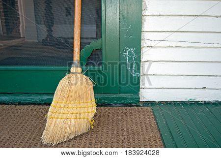 hobo cat symbol on green door jamb with used broom
