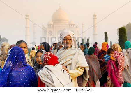 local colorful Indian visitors at worldwonder taj mahal in Agra India at sunrise