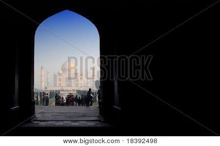 gate to worldwonder taj mahal in soft early morning light with blue sky