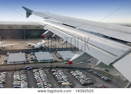 view on wing during landing at heathrow airport, london, UK