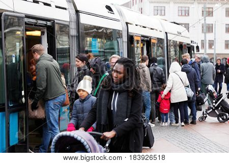 Gothenburg Sweden - April 16 2017: Passengers enters a articulated tram of class M32 at the stop Drottningtorget.