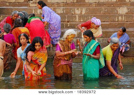 colorful hindu women bathing in the ganges in varanasi