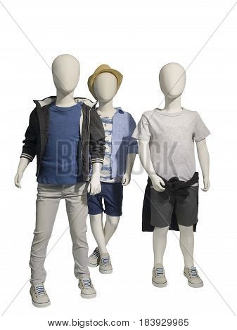 Three mannequins dressed in casual kids wear isolated on white background. No brand names or copyright objects.