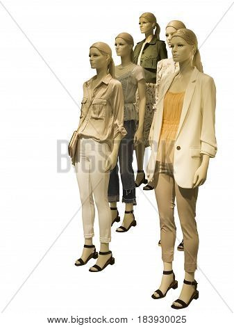 Group of female mannequins wear fashionable summer clothes isolated on white background. No brand names or copyright objects.