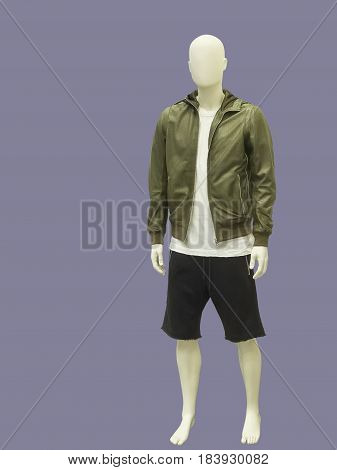 Full-length male mannequin dressed in jacket and shorts isolated. No brand names or copyright objects.