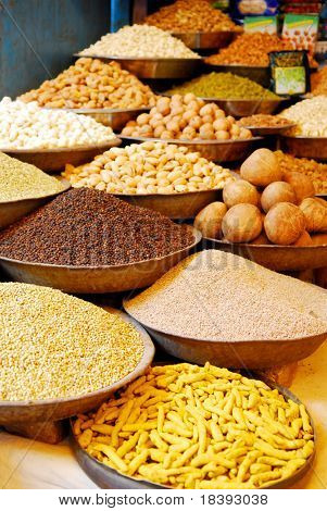bowls with spices and nuts at indian market