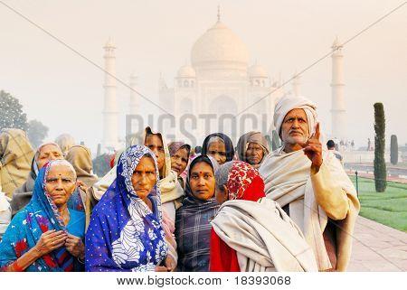 local colorful Indian visitors at worldwonder taj mahal in Agra India at sunrise