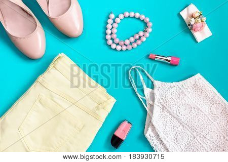 Female summer clothing collection in pastel colors, romantic style, top view