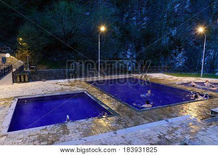 Borjomi Georgia - October 01 2016: Open air sulphur water swimming pools at Mineral water park in evening