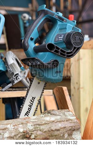 VILNIUS LITHUANIA - APRIL 27: Professional electric Makita brand chainsaw on April 27 2017 in Vilnius Lithuania. Makita Corporation founded on March 21 1915 it is based in Japan.