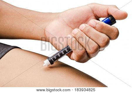 Man hands making injection with insulin pen or syringe at his leg. Isolated on white background Clipping path.