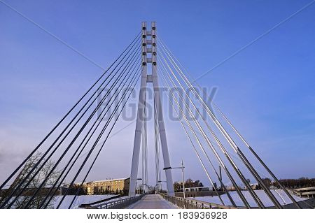cable-stayed bridge across the river on the background of blue sky
