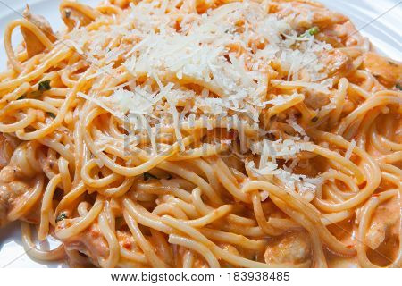 Spaghetti With Chicken, Cooked In Spicy Sauce From Tomatoes, Onion And Garlic.